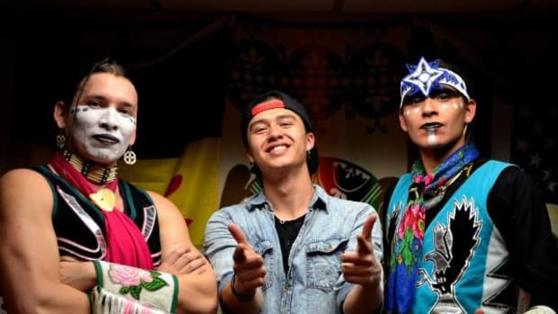 From left, Sam Sampson, Frank Waln, and Micco Sampson. The Sampson Bros dance on stage as Waln, a hip-hop artist, performs.
