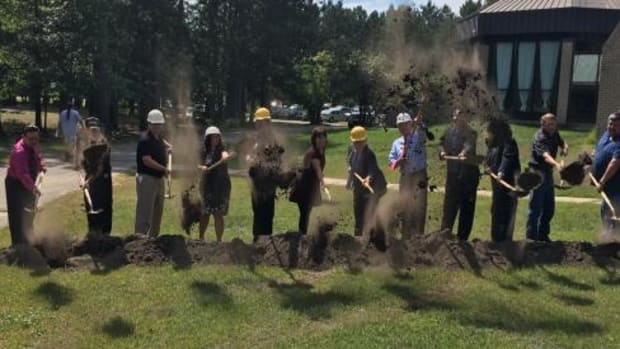 Dignitaries dig in at the groundbreaking ceremony for a new $11.9 million Bug-O-Nay-Ge-Shig high school that took nearly two decades to fund. The school is set to open on the Bug School campus near Bena, Minnesota, on the Leech Lake Band of Ojibwe Reservation.