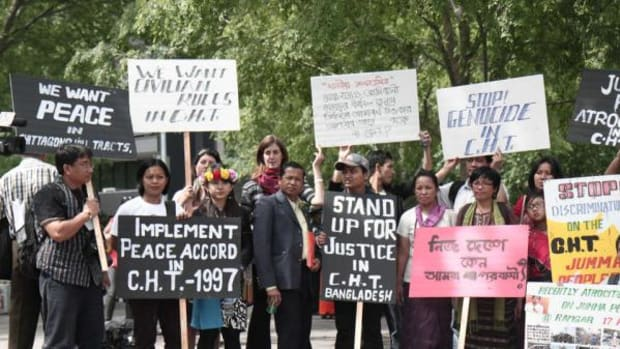: In this Survival International file photo, Jummas and indigenous people from around the world call for the Chittagong Hill Tract peace treaty to be honored outside the UN in New York in May 2011. This week the Jummas were back at the UNPFII still fighting for the Peace accord to be honored – four years later.