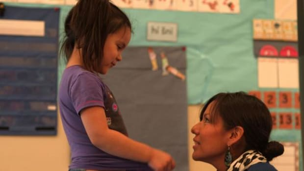 Language revitalization classes have become part of the curriculum in many Lakota Country schools. Here Tipiziwin Young teaches Kyyanlyn Eagle Shield.