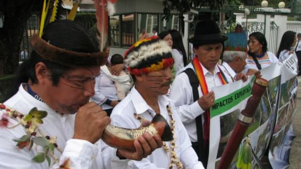 The Sarayaku people held a ceremony outside the Inter-American Court in Costa Rica the day of the hearing in July. Pictured is José Gualinga, Sarayaku President is blowing Horn.
