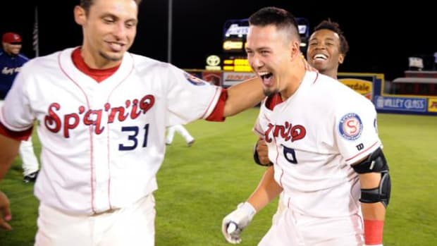 Connor McKay (right) reacts to his game-winning RBI single in the 10th inning.