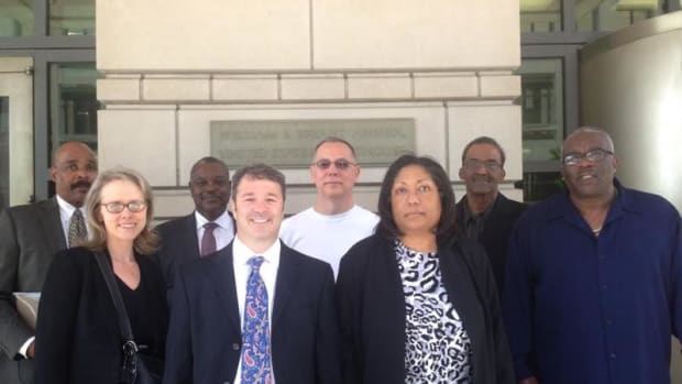 Jon Velie and Marilyn Vann, front center, with Cherokee Freedmen and the legal team outside U.S. District Court in Washington D.C. after presenting their last argument in their case on May 5, 2014.