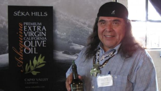 Marshall McKay, tribal chairman of the Yocha Dehe Wintun Nation, with the tribe's new olive oil at the Seka Hills Brand Launch at Mulvaney's B&L restaurant in Sacramento. (By Lisa Garrigues)