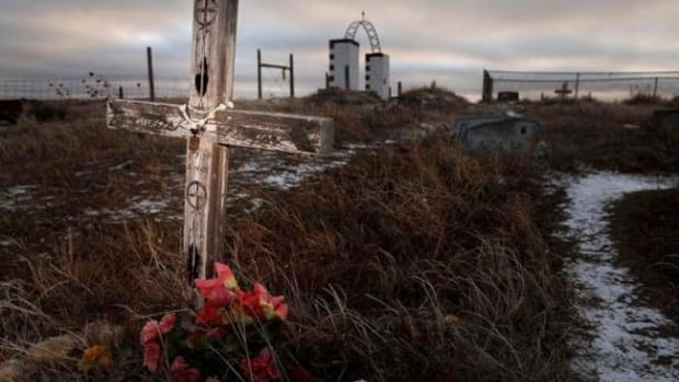 This Feb. 7, 2012 photo shows a cross on a grave at the Wounded Knee National Historic landmark in South Dakota.