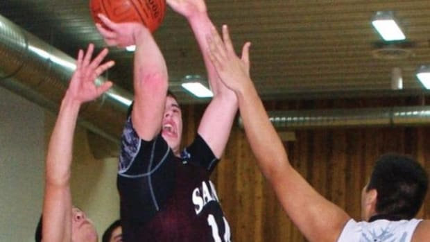Skidegate Saints player Joel Richardson,wearing black with ball, goes up strong for two points in a 66-62 win over the Heiltsuk Nation in the 2012 BC Junior All Native boys division final. Richardson was named tournament MVP
