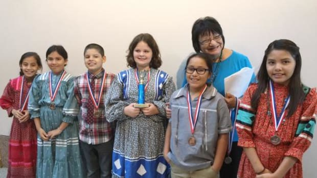 """Cherokee Immersion Charter School fourth-grade class won first place for singing """"Eternal Sabbath,"""" a traditional Cherokee song brought back from North Carolina. Students from left, are: Isabella Sierra, Ahnawake McCoy, Logan Oosahwe, Maleah Bird, Isaiah Walema and Jenna Dunn, with fluent Cherokee teacher Meda Nix."""