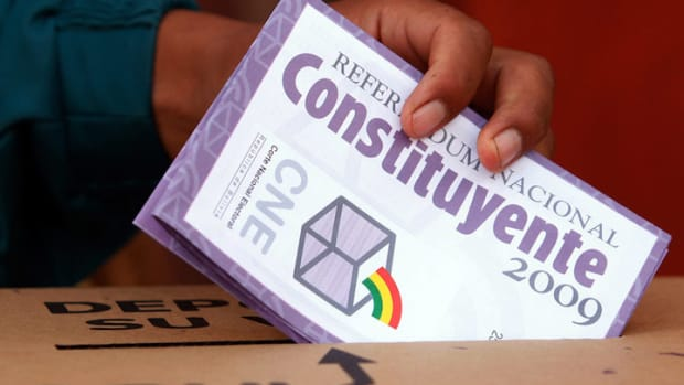A man casts his ballot in a referendum on a constitution at a voting center in El Alto, Bolivia on January 25, 2009. Bolivia's 2009 constitution recognizes the validity of indigenous justice in settling disputes.
