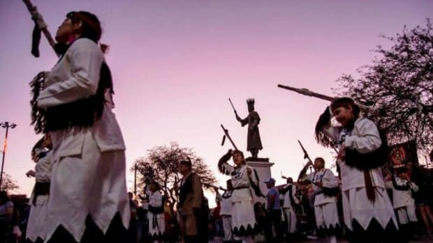 Members of the Religious Society Sioux Indians of Mary during a dance held in a sunrise as part of the celebration of La Tirana in honor of the Virgin of El Carmen in 2015.