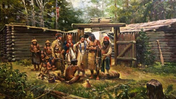 """On 20 November 1805 William Clark wrote in his journal, """"…one of the Indians had on a roab made of 2 Sea Otter Skins the fur of them were more butiful than any fur I had ever seen. Both Capt. Lewis and my Self endeavored to purchase the roab with different articles. At length we procured it for a belt of blue beads which [Sacagawea] wore around her waste."""" The scene depicted above is from a painting by Newman Myrah entitled """"Bartering Blue Beads for Otter Robe""""."""