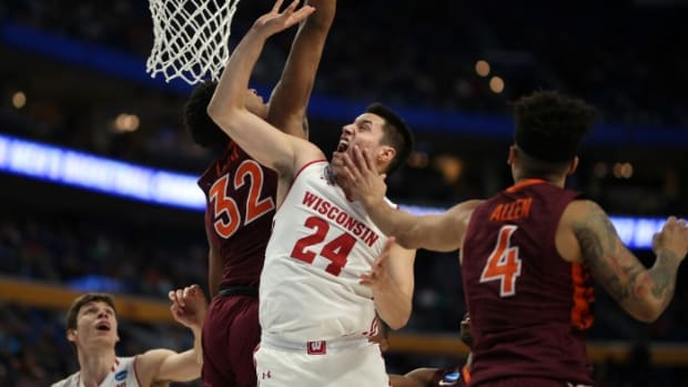 BUFFALO, NY - MARCH 16: Wisconsin Badgers guard Bronson Koenig (24) is fouled by Virginia Tech Hokies guard Seth Allen (4) during the NCAA Division 1 Men's Basketball Championship game between Wisconsin Badgers and Virginia Tech Hokies on March 16, 2017, at the Key Bank Center in Buffalo, NY. (Photo by Jerome Davis/Icon Sportswire) (Icon Sportswire via AP Images)