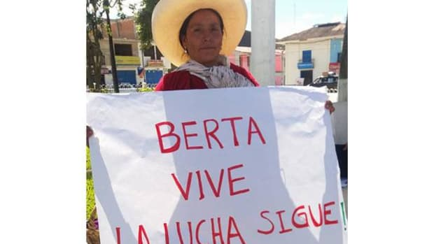 Maxima Acuña holding a Berta sign at a protest in Peru.