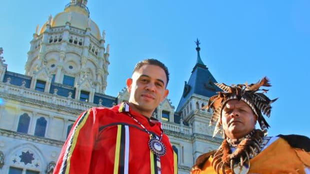 Mashantucket Chairman Rodney Butler and Wayne Reels, Mashantucket Director of Cultural Resources, stand before the Connecticut State Capitol, where the Pequot Flag flew for the first time in history from November 2 to 9 for Native American Heritage Month.