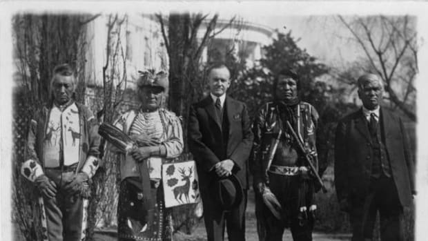 President Calvin Coolidge with four Osage Indians after Coolidge signed the bill granting Indians full citizenship in 1924.