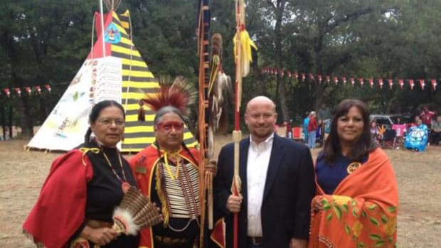 Joe Dorman making a campaign stop at the Kiowa Black Leggings Ceremonial on October 11, 2014. From left are Renee' Plata, member of the Kiowa Black Leggings Women's Auxiliary; Blas Preciado, Vice-Commander of the Kiowa Black Leggings Society; Dorman; and Janis Wermy, Kiowa Black Leggings Women's Auxiliary President.