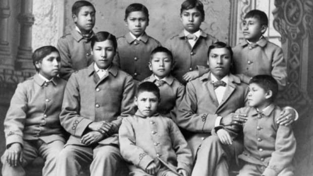 A group of Omaha Indian boys in their cadet uniforms at the militaristic Carlisle School, circa 1880