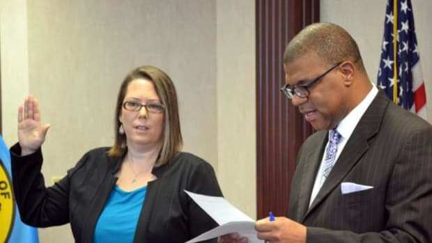 Deputy Attorney General Sara Hill receives the oath of office for her new special assistant United States attorney appointment from the Northern District of Oklahoma United States Attorney Danny Williams Sr.