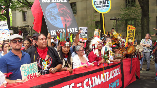 Leonardo DiCaprio, left, walked alongside Indigenous leaders and youth during the Peoples Climate March in Washington, DC on Saturday April 29, 2017.