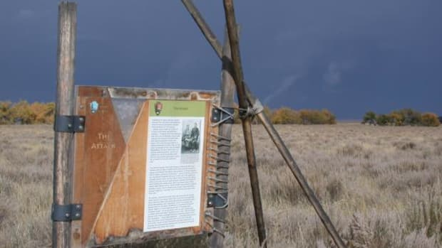An informational plaque at the Sand Creek Massacre National Historic Site tells the story of the massacre.