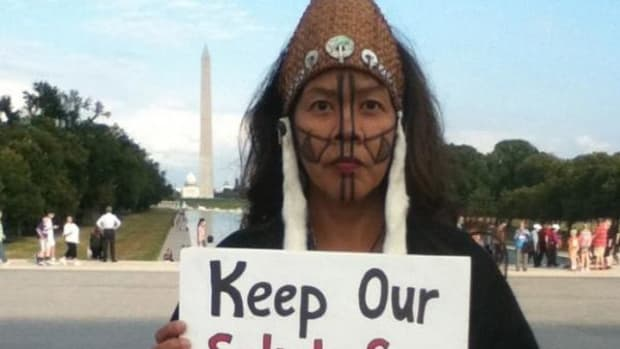 Idle No More Washington director Sweetwater Nannauck protests in 2014 at the National Mall against the proposed Gateway Pacific coal export terminal near the Lummi reservation.