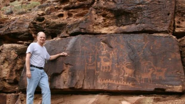 John A. Ruskamp stands near petroglyphs that he says match ancient Chinese script in Nine Mile Canyon, Utah.
