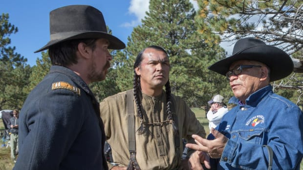 An on-set behind-the-scenes photo of Chief Phillip on the Hostiles set. From left to right: Christian Bale, Adam Beach and Chief Phillip Whiteman.