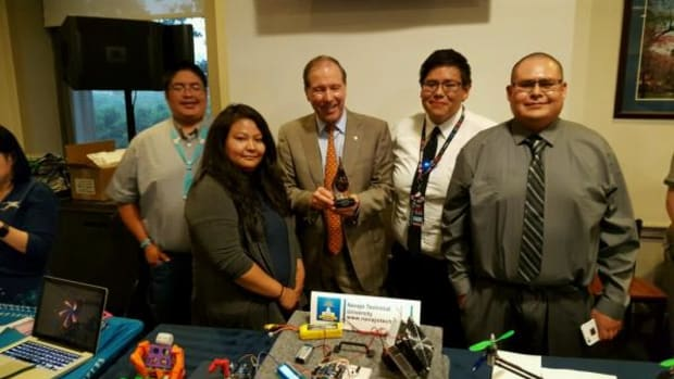 Senator Tom Udall with Navajo Technical University Maker Team at U.S. Capital Hill Maker Faire on June 21. Senator Udall is holding the trophy the NTU team received at the Innovation Challenge. Pictured, from left, are: Hansen Tapaha, Ericka Begody, Senator Udall, Chris Owens, and Kirsch Davis.