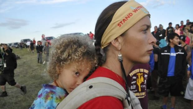 Mother and child at the frontlines on the Standing Rock Reservation in North Dakota on August 16, 2016. With so many Indigenous people, allies coming together to protect Mother Earth, in many ways, we have already won, writes Sarah Sunshine Manning.