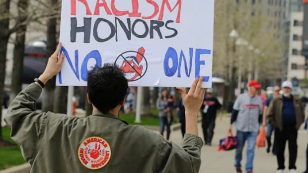Josh Hunt protests as fans walk to the ballpark before a baseball game, Tuesday between the Chicago White Sox and the Cleveland Indians, April 11, 2017, during opening day in Cleveland. Hunt is from the Cheyenne and Arapaho Tribe.