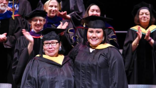 Carol and Kelly Walker at hooding ceremony, where they received a standing ovation after the announcement that mother and daughter were graduating together.