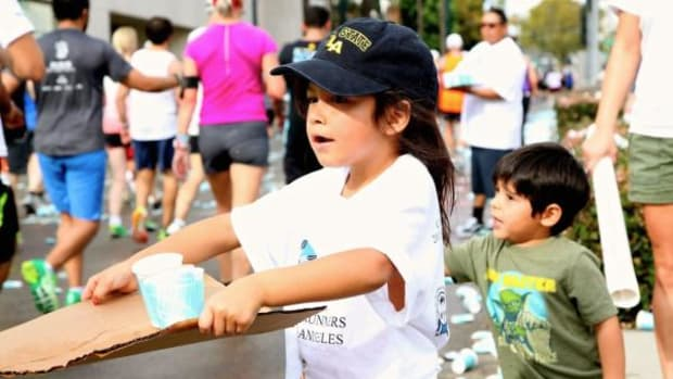 Young helpers pass out water to runners in the L.A. Marathon at the American Indian Community Council's water station.Photo by Pamela J. Peters/Tachiinii Photography.