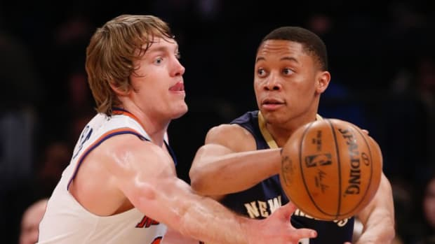 New Orleans Pelicans guard Tim Frazier (2) passes around New York Knicks guard Ron Baker (31) during the second half of an NBA basketball game at Madison Square Garden in New York, Monday, Jan. 9, 2017. The Pelicans defeated the Knicks 110-96. AP Photo / Kathy Willens