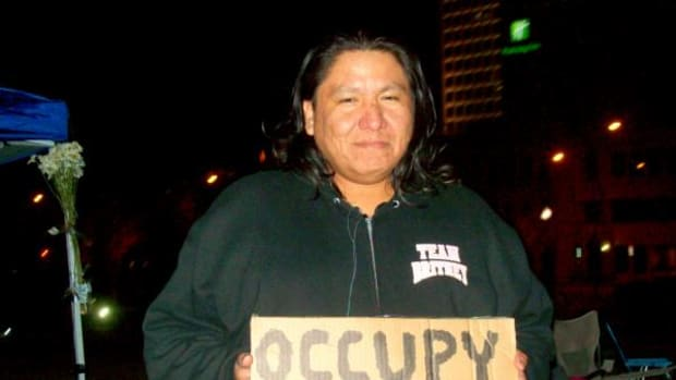 Joe Briggs Jr., Cheyenne-Arapaho, a filmographer who was documenting the Occupy Tulsa movement and has since joined the cause after witnessing police pepper spray the protesters on November 2.