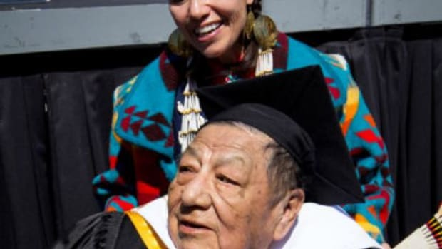 Sandra One Feather laughs with her father, Gerald, during ceremonies last year at the University of Colorado—Boulder at which he received an honorary doctorate in recognition of his years supporting tribal education.