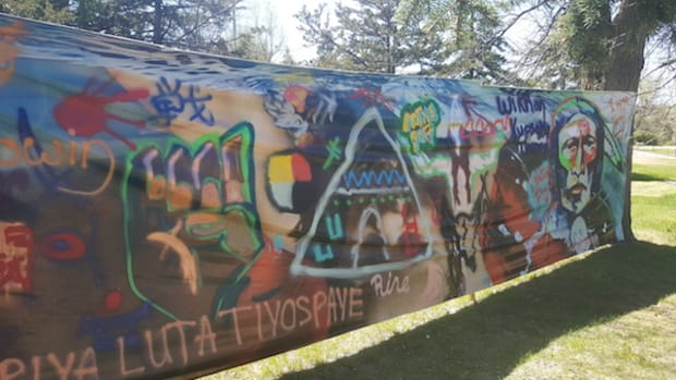 "Native Pop artists empowered youth to make graffiti. They joined forces with Red Cloud Indian School students, as well as visiting youth, to paint a mural on a vinyl canvas. One youth wrote: ""Escape Reality,"" Learned said."