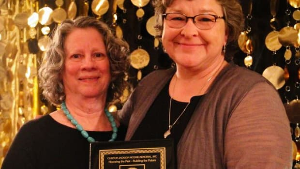 Karen Diver, right, accepts an award from Susan Ault, co-chair of the Clayton Jackson McGhie Memorial organization.