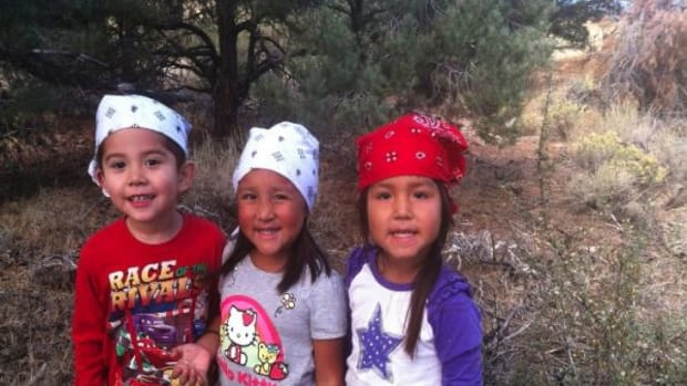 Children In the Washoe Tribe's Head Start program pick pine nuts to make pine nut soup for the Pine Nut Celebration.