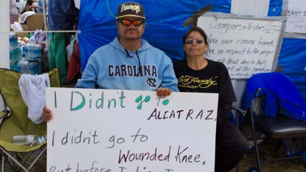 Dave Iron Cloud, Oglala Lakota, and Yvette Gray, Yanktonai and Hunkpapa Lakota, sit and listen to speakers share their stories in the camps at Standing Rock. Thousands of people have traveled to the Sacred Stone camp near the Standing Rock reservation in North Dakota to fight a pipeline there.