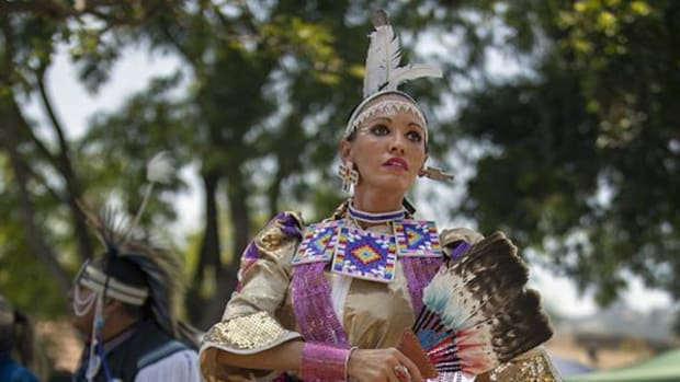 Jingle dress dancer Kathryn Draper, Choctaw/Creek, dances in an intertribal during the Celebrating All Life and Creation Pow Wow in West Hollywood's Plummer Park, on Saturday afternoon, June 28, 2014.