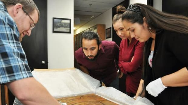 Sealaska Heritage Institute Archivist and Collections Manager Zach Jones and SHI's Mike Hoyt, Carmaleeda Estrada and Davina Cole see the panel for the first time.