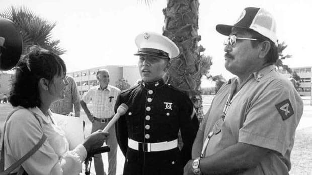 U.S. Marine Honorman, Michael V. Smith (Acoma/Navajo) next to his Navajo Code Talker father, Samuel Smith, getting interviewed at Camp Pendleton.