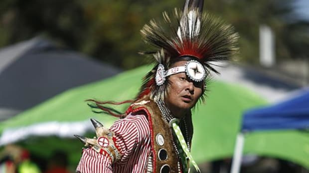 Northern traditional dancer Kenny Donaghey, Diné, dances during competition, on Saturday afternoon, March 28, 2015, during the 2nd Annual University of Redlands Pow Wow.