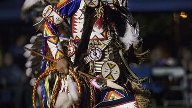 Lakota northern traditional dancer Nathan Lee dances during an intertribal on Saturday night, during the University of Redlands Powwow.