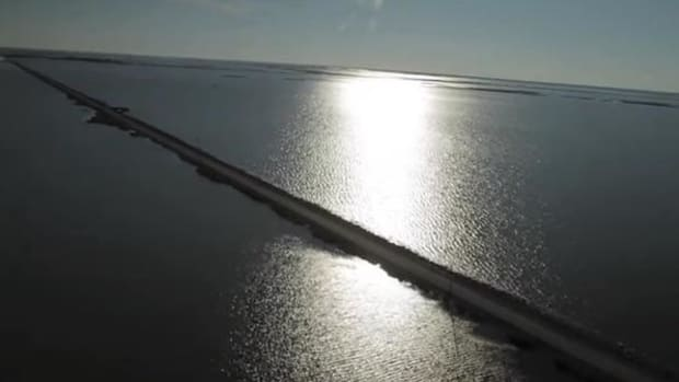 The road to Isle de Jean Charles, home of the Biloxi-Chitimacha-Choctaw band off the Louisiana coast, is fast disappearing, as is the island itself. The band has just received $48 million for relocation.