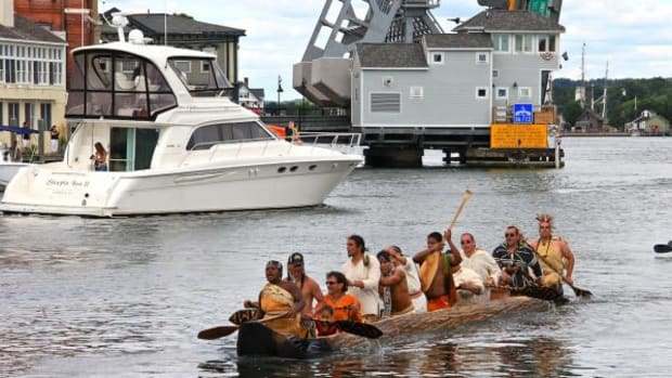 The new mishoon completed its first voyage of six miles in downtown Mystic, Connecticut, where passengers on boats readied their cameras and well-wishers gathered to welcome the group's return.
