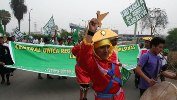 Traditional musicians and dancers accompany the protesters from Cajamarca as they arrive in Lima.