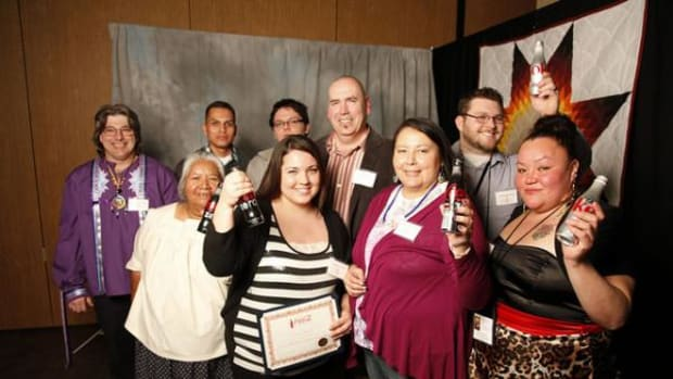 Reed Sutton, with High Country Coca-Cola (pictured center), poses with recipients of the Coca-Cola First Generation Scholarship recipients at the Annual Student of the Year/Coca-Cola First Generation Student Awards Banquet photo booth during the 33rd Annual AIHEC Student Spring Conference in Billings, Montana, on Sunday, March 16, 2014.