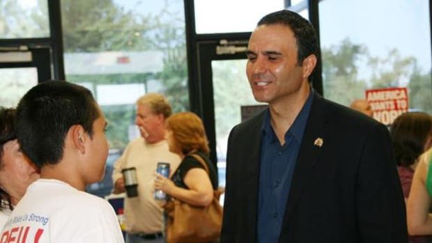 Paul Penzone, the newest challenger to longtime Maricopa County Sheriff Joe Arpaio's 20-year tenure, chats with supporters recently.