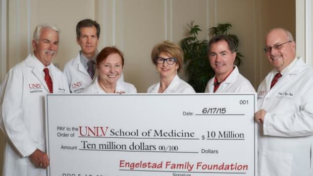 Pictured, from left, are UNLV Vice President for Advancement Bill Boldt, Regent Mark Doubrava, UNLV School of Medicine Dean Barbara Atkinson, Engelstad Family Foundation's Kris Engelstad McGarry, UNLV President Len Jessup, and Board of Regent Chair Kevin Page pose with an oversized check June 16, 2015 at the Engelstad Family Foundation Offices in Las Vegas.