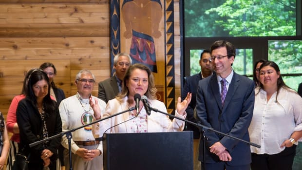 Quinault Indian Nation President Fawn Sharp speaks at the announcement in Seattle of the State Attorney General's new policy requiring free, prior and informed consent from Washington tribes. Attorney General Bob Ferguson stands beside her.